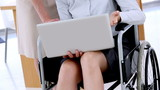 Businesswoman in a wheelchair working with a laptop