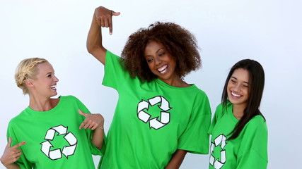Laughing women with green ecologic t-shirt