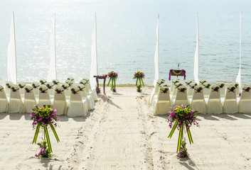 Wedding ceremony on the beach .