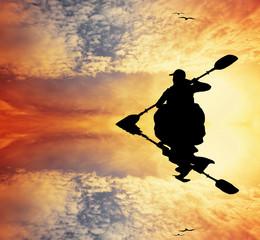 Kayak silhouette at sunset