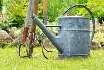 Watering can and garden tools