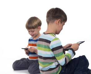 boys playing games on tablet computers