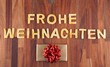 Frohe Weihnachten with cookies and gift