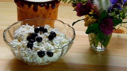 Blueberries mixed with cottage cheese in a bowl