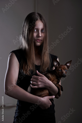 Beautiful evil teen girl with little doggy