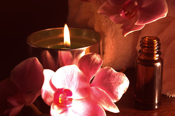 Orchid, candle,bottle of oil