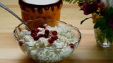 Berry cranberries mixed with a spoon with cottage cheese