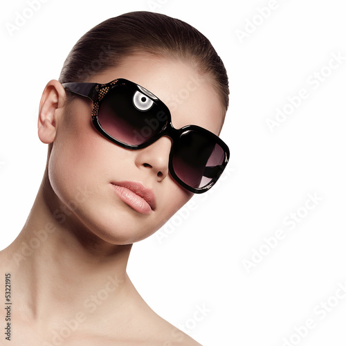 Fashionable woman in sunglasses. Isolated over white