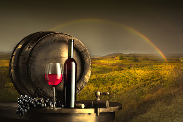 still life with red wine and old barrel