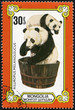 stamp shows the female and baby panda in a washtub