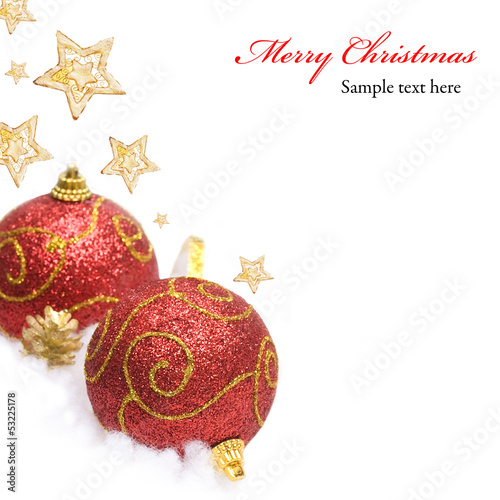 Red Christmas bauble and stars on white background