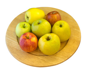 Apples on wooden plate