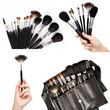 Women hands holding make-up brushes