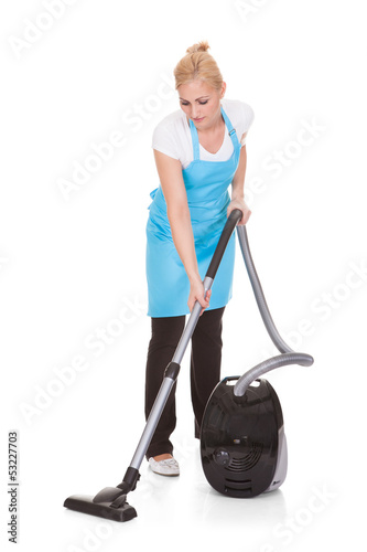 Portrait Of Woman Holding Vacuum Cleaner