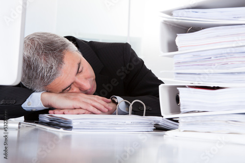 Mature Businessman Sleeping At Desk