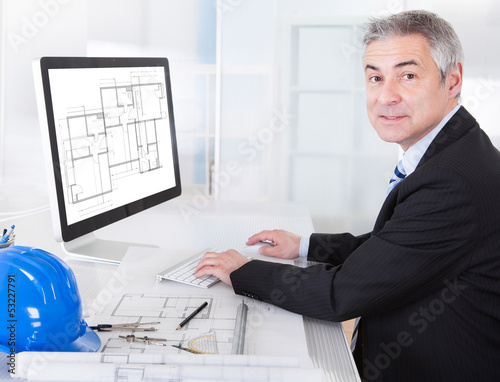 Mature Architect Male Working At The Desk