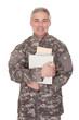 Mature Soldier Holding Stack Of Books