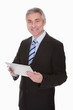 Mature Businessman Holding Digital Tablet