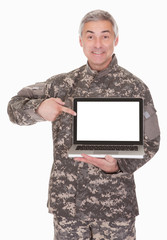 Mature Soldier Showing Laptop