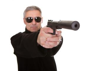 Mature Man Aiming With Handgun