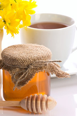 closeup of honey,  tea and flower