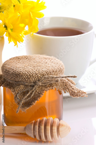 closeup of honey, tea and flower © zaretskaya