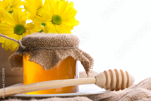 closeup still of honey and flowers © zaretskaya