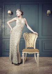 Beautiful woman retro portrait in vintage interior