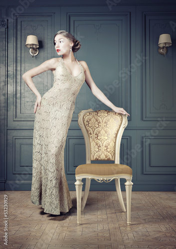 Beautiful woman retro portrait in vintage interior
