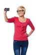 Blonde woman wearing glasses taking self portrait photo
