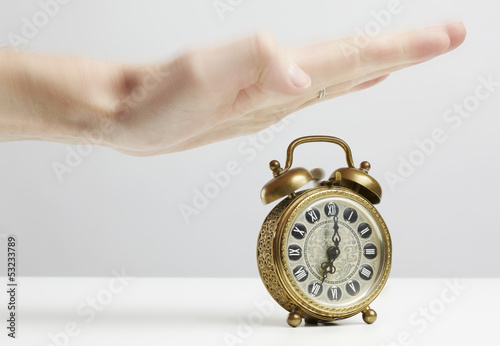 Hand stopping alarm on clock