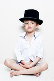 portrait of a naughty boy possing with top hat
