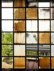 pattern of old broken industry window gives a harmonic backgroun