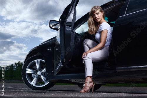 Lady and a car