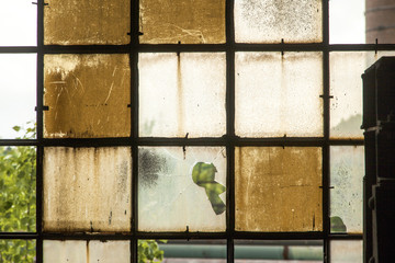 pattern of old broken industry window gives a harmonic backgroun