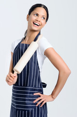Happy baker holding rolling pin