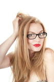 Portrait of beautiful embarrassed  girl in glasses, isolated