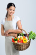 Woman with fresh vegetables from farmers market