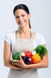Happy healthy woman holding vegetables