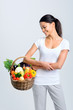Woman with raw fresh produce in a basket