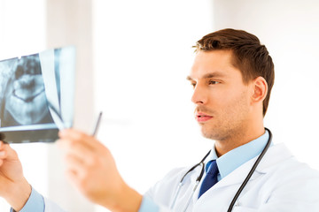 male doctor or dentist looking at x-ray