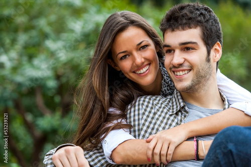 Young couple in park.