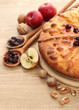 tasty homemade pie with jam and apples, on wooden table