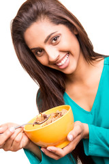 Beautiful mix race woman eating cereals