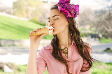 Young beautiful woman eating ice cream outdoors