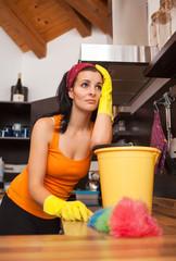 Portrait of overworked woman in kitchen