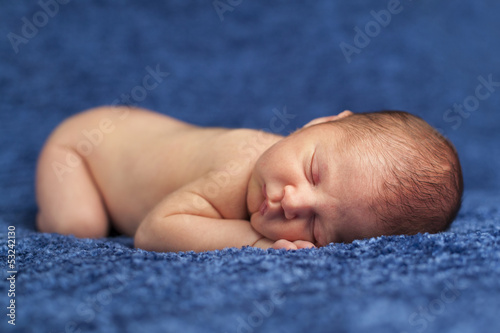 Adorable newborn baby sleeping in a blanket