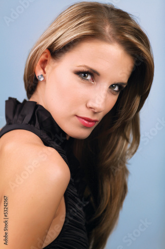 Young attractive woman on blue background
