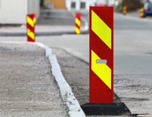 Red and yellow striped caution road sign