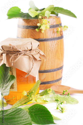 Linden honey jar and barrel with flowers